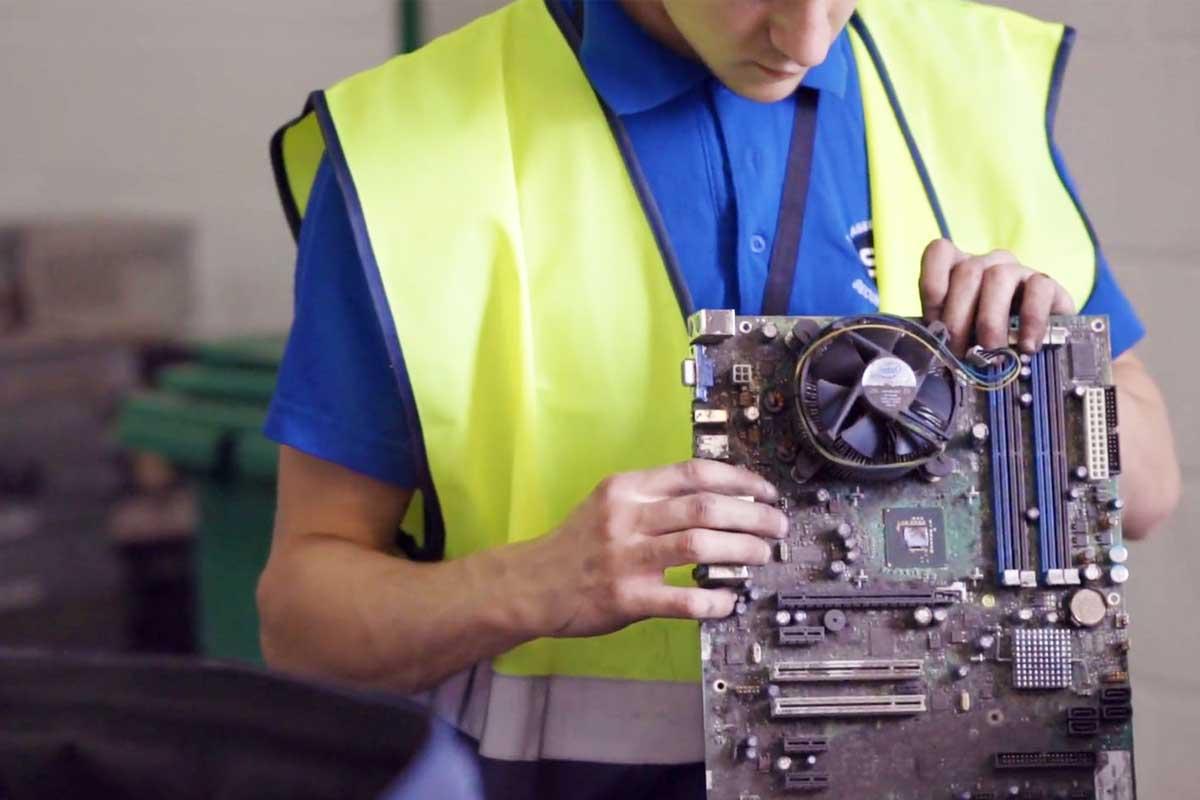Technician reviewing circuit board