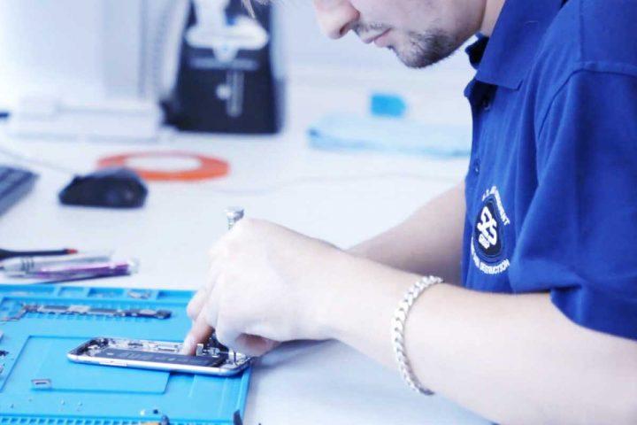 Technician repairing smartphone