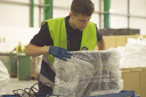 Employee packing IT equipment